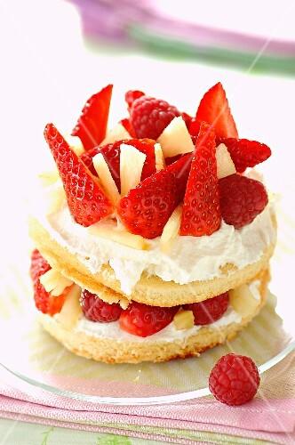 Strawberry cream sponge dessert with raspberries and pineapple
