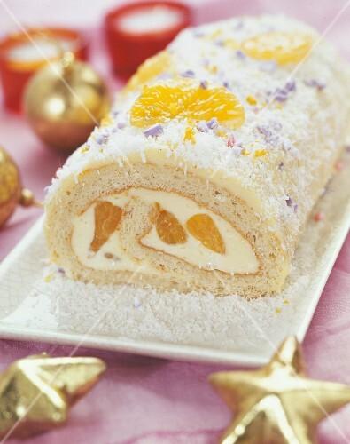 White chocolate, mandarin and coconut Christmas log cake