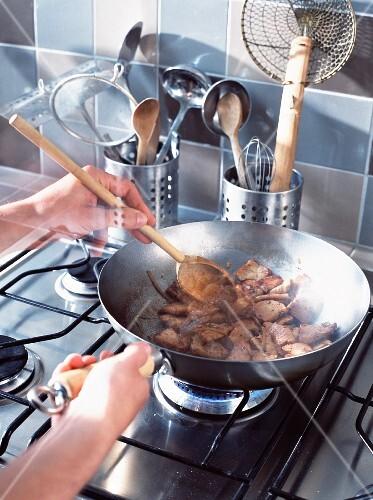 Stir frying pork in pan