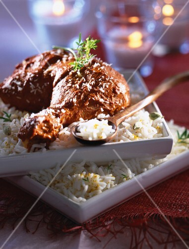 Chicken tandoori drumstick on bed of rice