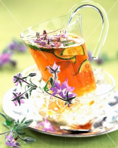 Mug of herbal tea with flowers