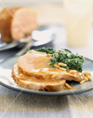 Roast porc with cider,spinach and pine nuts