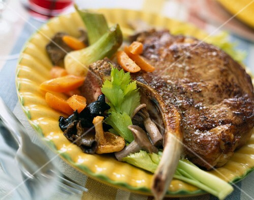 Veal chop with mushrooms, carrots and celery