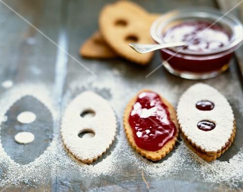 Preparing jam sandwich biscuits