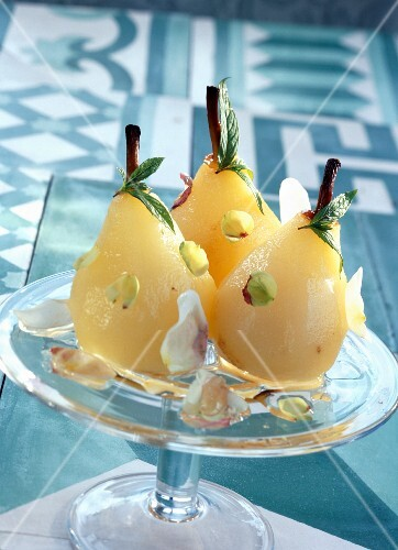 Poached pears with rose petals