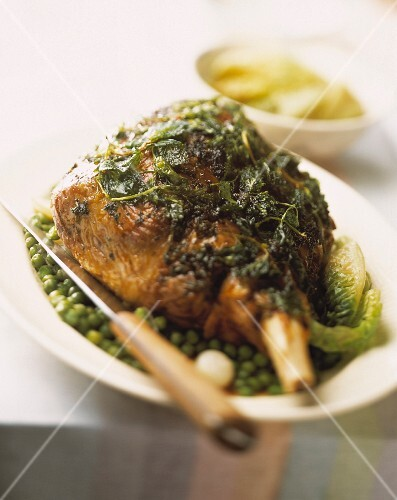 Leg of lamb with herbs, peas and lettuce