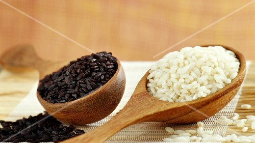 Spoonfuls of black sticky rice and pudding rice