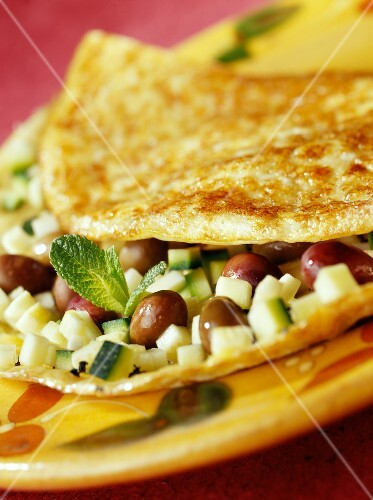Omelette with olives,courgettes and fresh mint ( topic : omelettes)