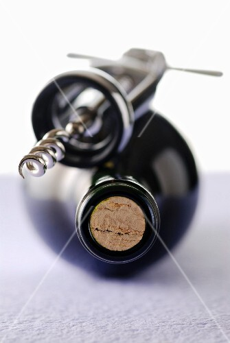 Bottle of wine and corkskrew