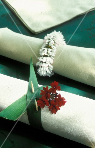 A white fabric napkin with a floral decoration