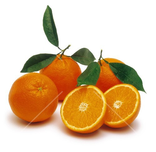 Whole and sliced oranges