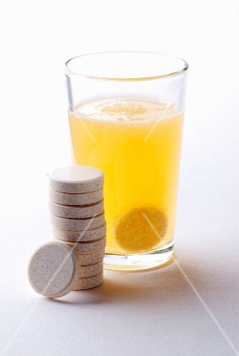 Effervescent tablet of vitamin c in a glass of water