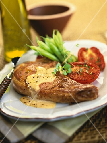 Veal chop with cheese sauce