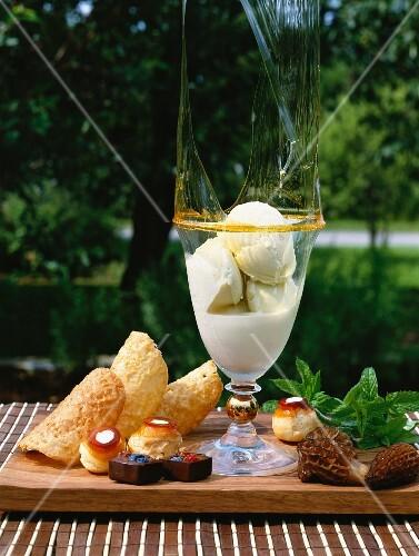 Vanilla ice cream with caramel, cones, profiteroles and morel mushrooms