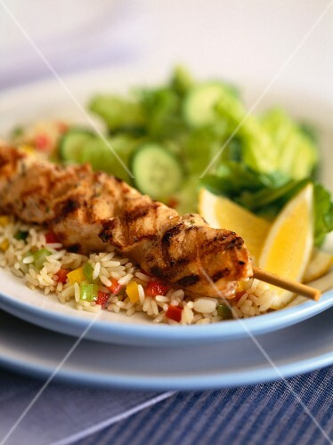 Pork skewers with cucumbers and rice