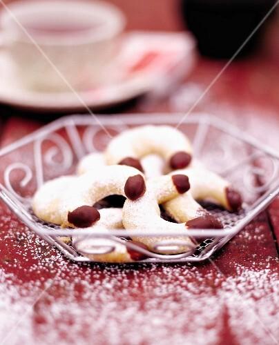 Cornes de gazelle (North African almond crescent biscuits) with vanilla sugar and chocolate glaze