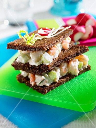 A prawn sandwich on black bread