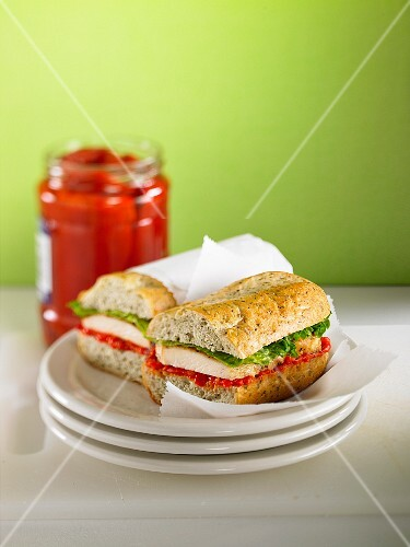 A chicken sandwich with pepper coulis