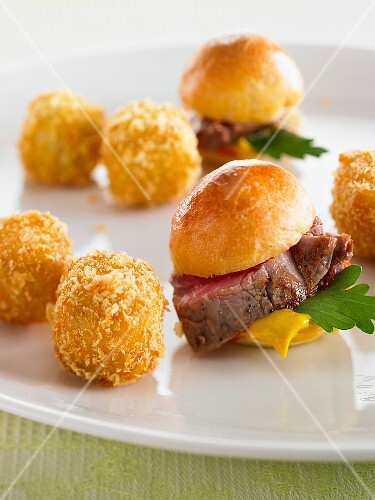 Potato croquettes and brioche rolls with beef