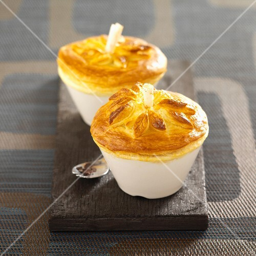 Meat pies with truffles and a bread topping