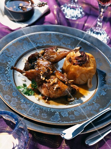 Glazed partridge with nougat served with baked apples with almonds