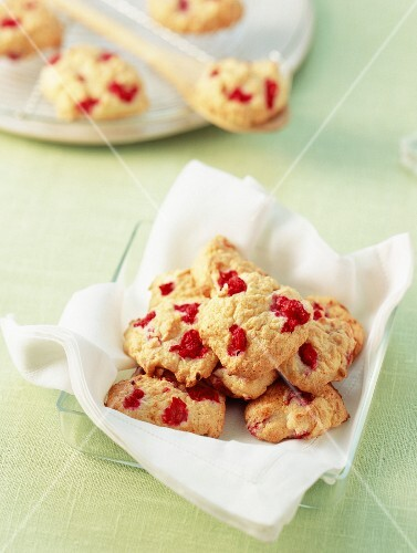Biscuits dacquoise (egg white and almond biscuits) with coconut and chopped raspberries