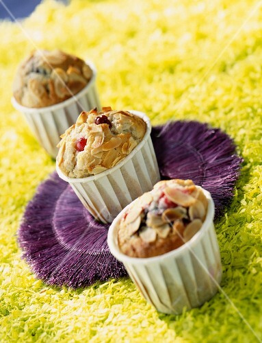 Fruits of the forest muffins with flaked almonds