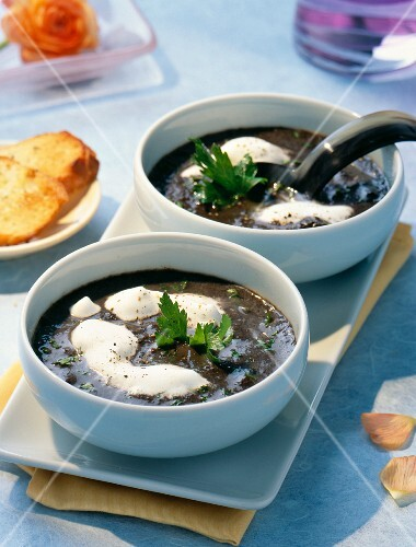 Mushroom soup topped with cream