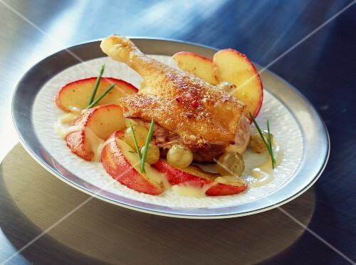 Turkey leg with flash fried apples and grapes