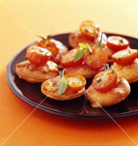 Mini pizzas with buffalo mozzarella and cherry tomatoes