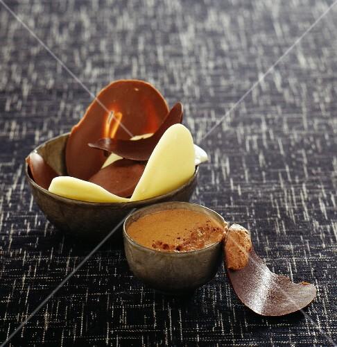 A chocolate dessert featuring a trio of chocolates