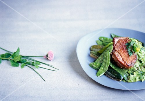 Chicken with mange tout and a herb sauce