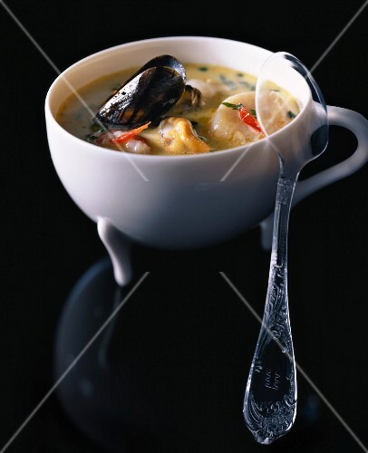Seafood soup with coconut milk and chilli