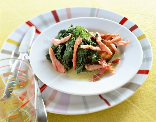 Spinach with strips of salmon