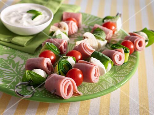 Ham,tomato,feta and courgette brochettes