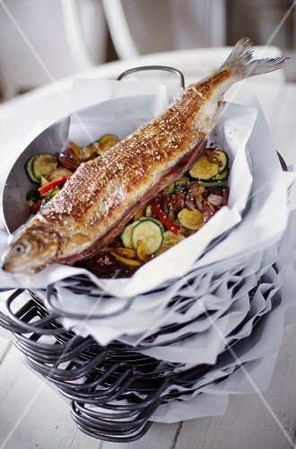 Trout and vegetables cooked in a wok