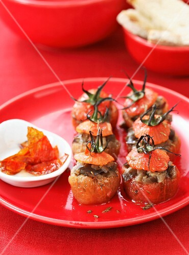 Stuffed mini tomatoes filled with aubergine and caraway seeds
