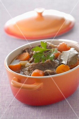 Beef and carrot stew in a casserole dish