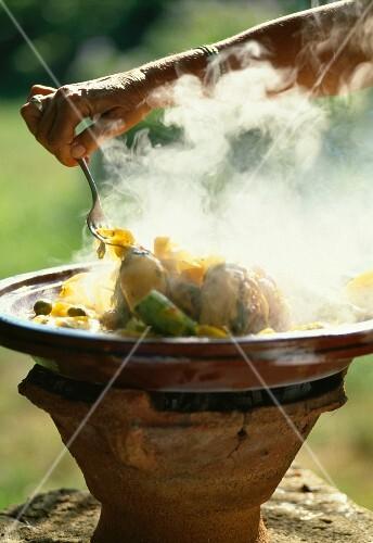 Fatima chicken Tajine cooked on a Kanoun