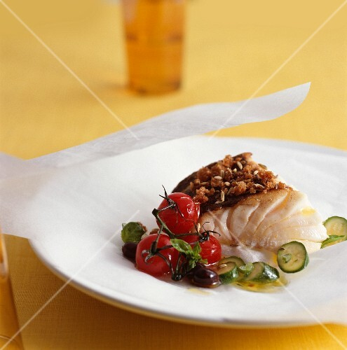 Cod with a caraway crust and summer vegetables on parchment paper