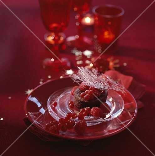 Chocolate cake with nougat and red berries