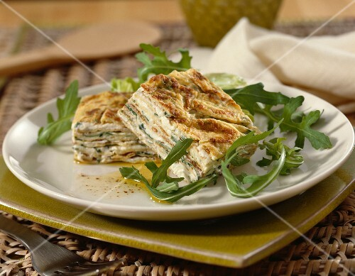 Omelette cake with garlic and fresh herbs