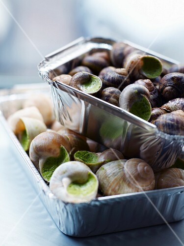 Aluminium containers of snails with parsley butter