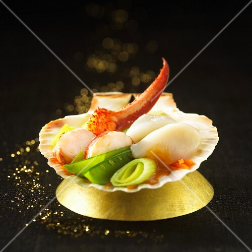 Scallops with lobster and vegetables