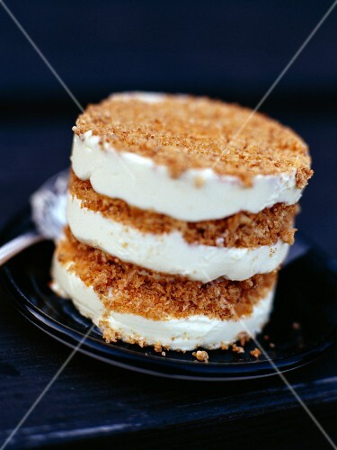 Layered cake with ice cream and crepe dentelle wafer crumbs