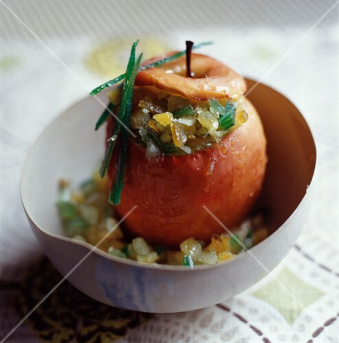 A baked apple with candied fruits and angelica