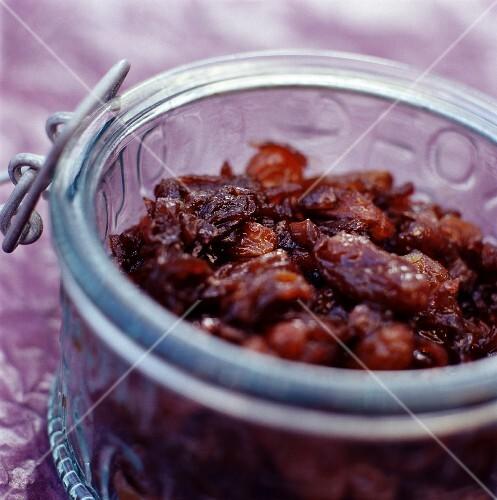 A jar of dried fruit chutney