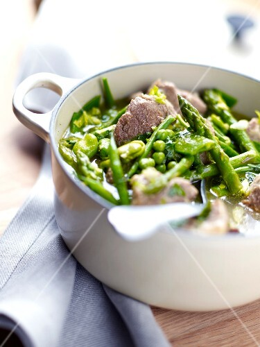Casserole dish of lamb and green vegetables