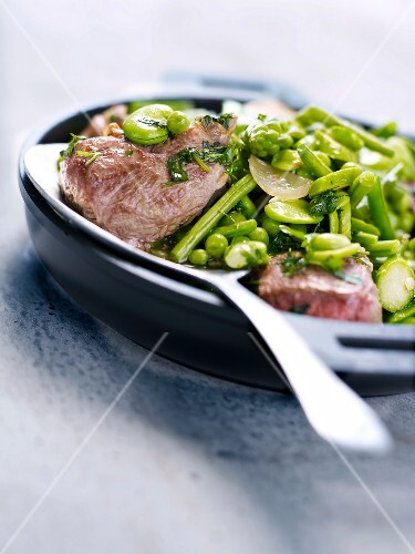 Cubes of lamb with green spring vegetables