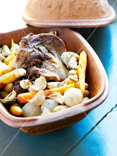 Lamb,vegetables and garlic cooked in a casserole dish